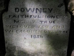 A memorial stone in the wall at the Dark Arch