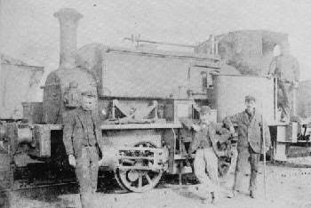 Probably Ignifer, at Aberford in about 1893. Tom Roberts is on the footplate, Thomas Townsend the station master is in the centre