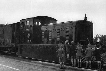 Brand new Drewry shunter No. 11102 being admired by local children