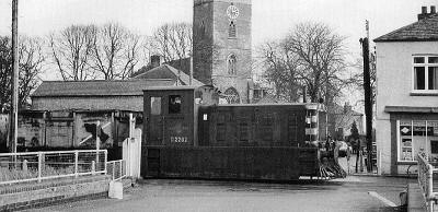 Drewry shunter No. D2202 shunts the Outwell yard in front of St. Clements Church in 1958