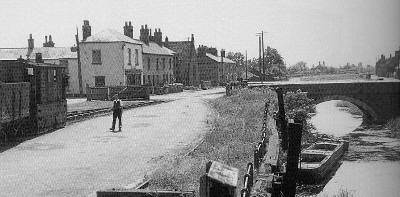 A J70 shunts a sleepy Outwell village yard in 1950