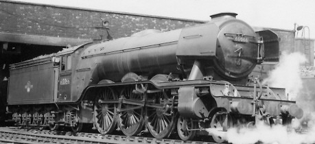 Gresley A3 Pacific No. 60066 'Merry Hampton' with smoke deflectors, at Kings Cross in 1963 (PH.Groom)